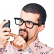 Young Doubtful Man Typing on Mobile — Stock Photo