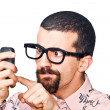 Young Doubtful Man Typing on Mobile — Stock Photo #7391460