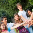 Happy Teenage Group with Hands on Stack — Stock Photo #7391595