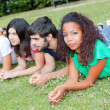 Royalty-Free Stock Photo: Group of Teenagers Lying on the Ground at Park