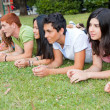 Group of Teenagers Lying on the Ground at Park — Stock Photo
