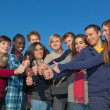 Stock Photo: Happy College Students with Thumbs Up