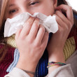 Sick Woman Blowing Her Nose — Stock Photo #7860355