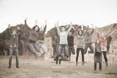 Multicultural College Students Jumping — Stockfoto