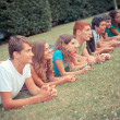 Group of Teenagers Lying on the Ground at Park — Stock Photo #7920993