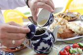 Pouring of tea after lunch — Stock Photo