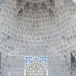 Deep niches and diverse muqarnas decoration in Guri Amir complex — Stock Photo