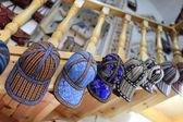 Caps in uzbek store — Stock Photo