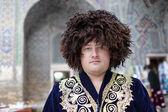Man poses in uzbek clothes — Stock Photo