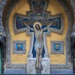 Crucifix on the wall - Stock Photo