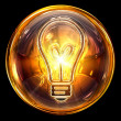 Bulb icon golden, isolated on black background - Stockfoto
