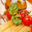 Royalty-Free Stock Photo: Pasta, olive oil and tomatoes on the wood background