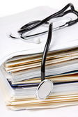 Stethoscope on the stack of paper — Stock Photo
