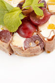 Tiramisu Sushi Roll garnished with Grapes and Mint — ストック写真