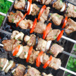 Royalty-Free Stock Photo: Kebab grilled with vegetables on metal skewers