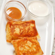 Pancakes with sour cream - Stock Photo