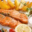 Salmon steak with roasted vegetables - Stock Photo