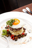 Beef burger with egg and potatoes — Stock Photo
