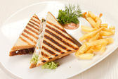 Sandwiches with French fried potatoes — Stock Photo