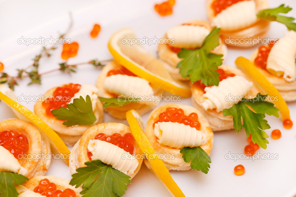 Canapes with red caviar and lemon stock photo shebeko for Canape with caviar