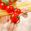 Pasta, olive oil and tomatoes on the wood background — Stock Photo #6971279