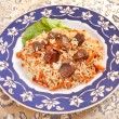 Uzbek national dish - plov on plate — Stockfoto #6971540