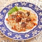 Uzbek national dish - plov on the plate — Stock Photo #6971540
