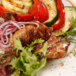 Meat with grilled vegetables — Stock Photo