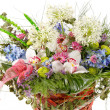 Beautiful flowers in the basket - Stock Photo