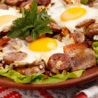 Sausage and eggs for breakfast — Stock Photo