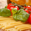 Pasta, olive oil and tomatoes on the wood background — Stock Photo #6973103