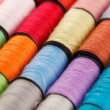 Bobbins of lurex thread - Stock Photo
