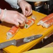 Chef preparing sushi in the kitchen — Stock Photo