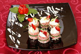 Tiramisu Sushi Roll garnished with Strawberry and Mint — Stock Photo
