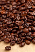 Coffee beans on the parchment — Stock Photo
