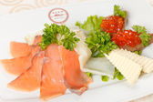 Appetizer with smoked salmon — Stockfoto