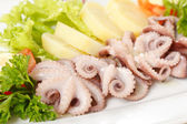 Octopus with potatoes — Stock Photo