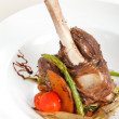Lamb chops on a bed of vegetables — Stock Photo #6981051