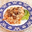 Uzbek national dish - plov on the plate — Stock Photo #6981962