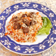 Uzbek national dish - plov on the plate — Stock Photo