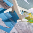 Stock Photo: Airliner with maps