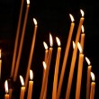 Foto Stock: Candles in a church