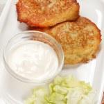 Potato pancakes with the sour cream — Stock Photo