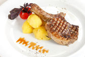 Steak served with potatoes — Stock Photo