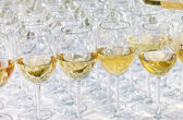 Glass drink white wine on buffet outdoor party — Stock Photo