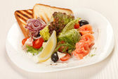 Tasty appetizer with salmon — Stock Photo