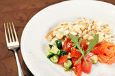 Scrambled eggs with salmon and vegetables — Stock Photo