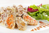 Fricassee with seafood and salad — Stock Photo