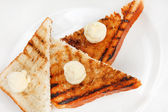 Three toasted bread slices for breakfast on the white plate — Stock Photo