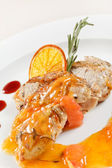Chicken with orange sauce — Stock Photo